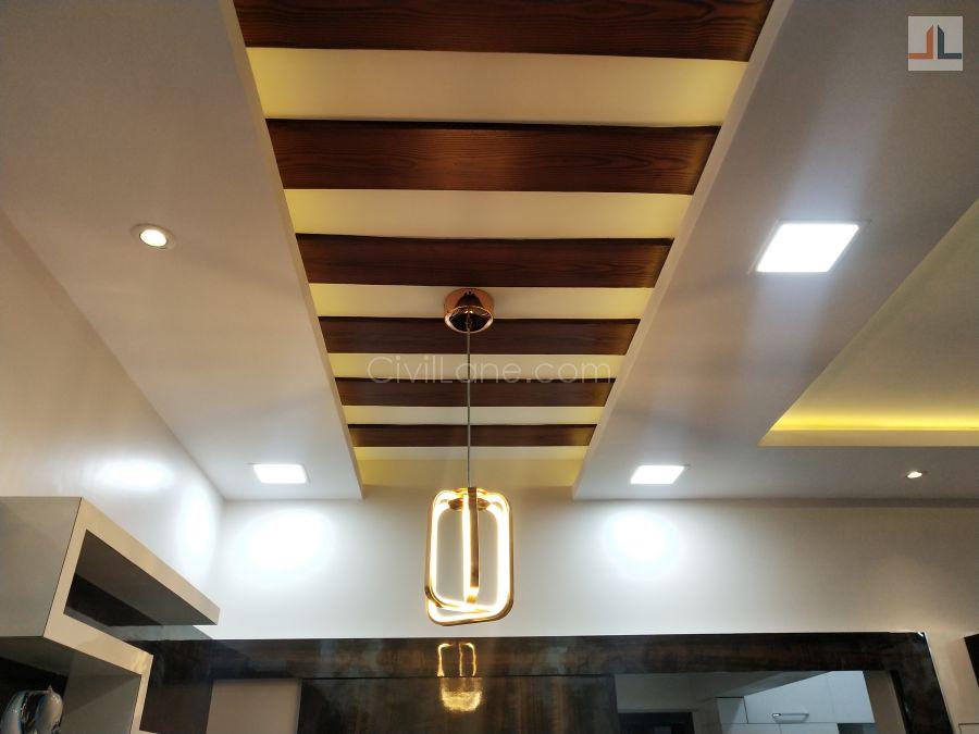 Wooden rafter false ceiling design dining area