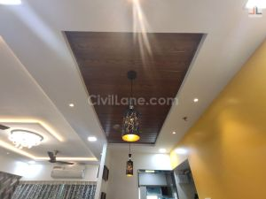 Dining-Area PVC False Ceiling Design Wooden Texture Hanging Lights
