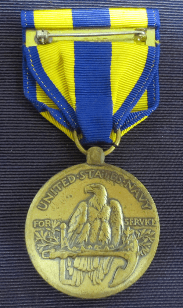 Gold medal with blue and yellow ribbon