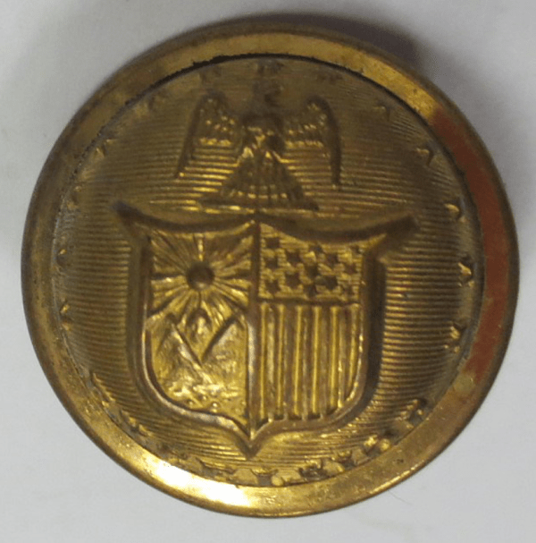Shield on a gold button