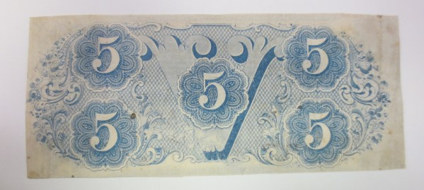 Back portion of currency with numbers 5