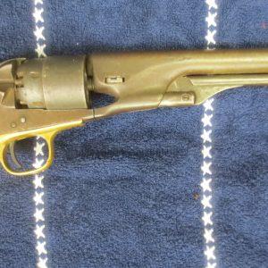 Gold colt pistol