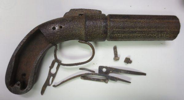 Dismantled curved pistol