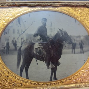 Picture of a man riding a horse inside frame