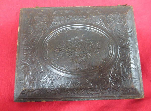 Back part of the frame with carved design