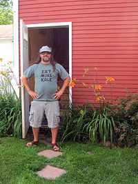 Bo Muller-Moore infront of his Eat More Kale studio