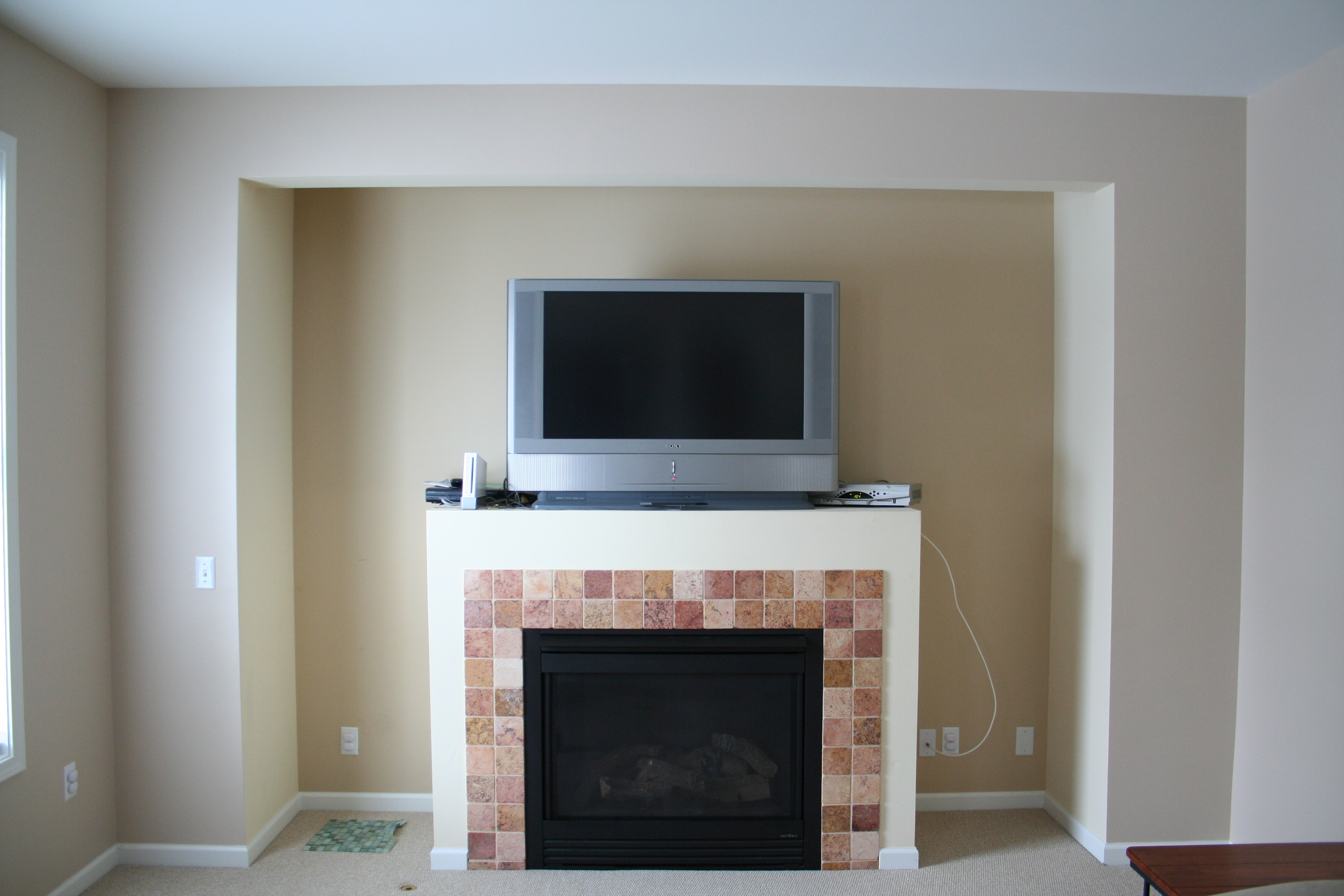 Shelving around fireplace  Cipolla Designs
