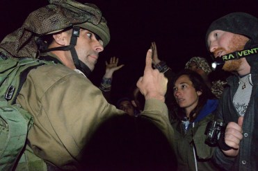 The Israeli army arrives and confiscates our tents, generator and supplies (photo credit: Ethan Miller)