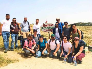 A group from the Spring 2019 delegation spends a few days working at Sumud: Freedom Camp (photo credit: Laura Vitale)