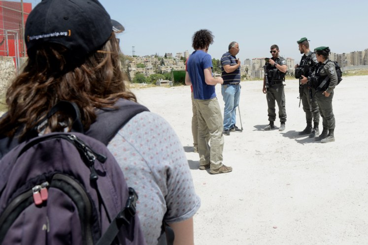 Israeli Border Police bothering us during our work project in Issawiya