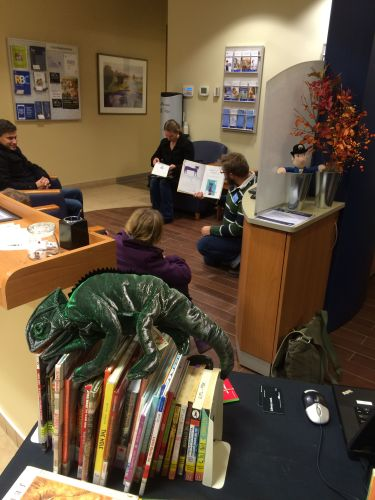 Edmonton Public Library - Families enjoy an impromptu storytime at the Pop Up Library in a local bank