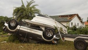 tangled car and boat after tornado