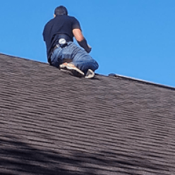 company adjuster inspecting roof claim