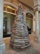 A Christmas tree made of yarn and rope.