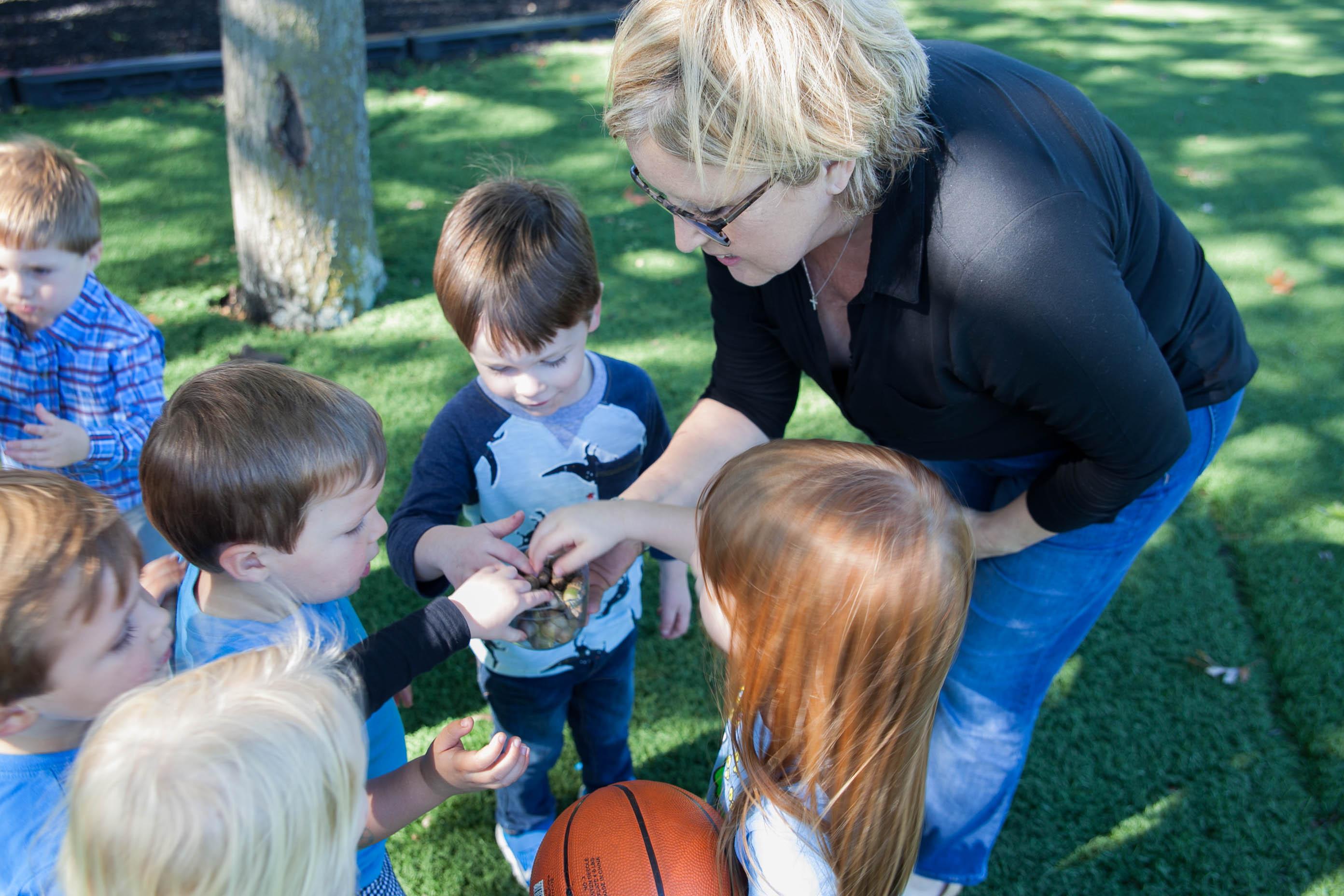 Claire's teacher with children
