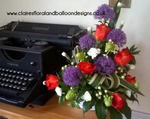 Asymmetrical rose and allium gift arrangement
