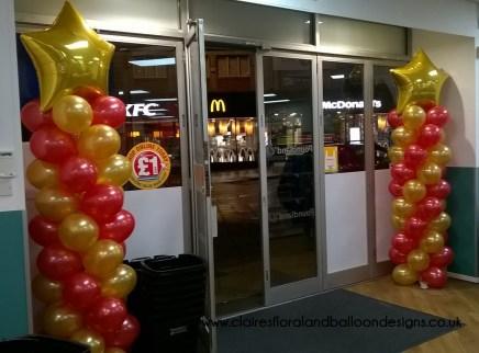 Poundland corporate balloon columns