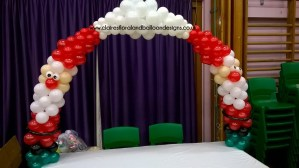 Father Christmas themed balloon table arch