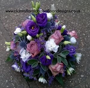 Rose, lisianthus and eryngium funeral tribute
