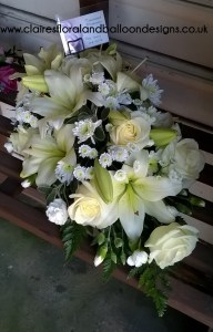 Rose, lily and chrysanthemum funeral coffin spray