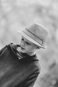 Black and White image of boy in a hat