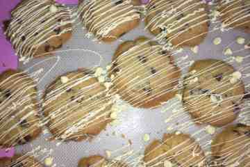 Chocolate Chip Cookies with a white chocolate drizzle