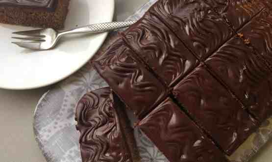 Chocolate Tray bake with an easy to slice hardened chocolate topping.
