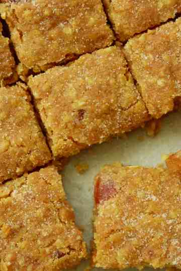 Cherry, Oat and White Chocolate Cookie Bars cut into small square slices