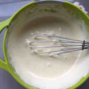 cake batter in a green bowl.