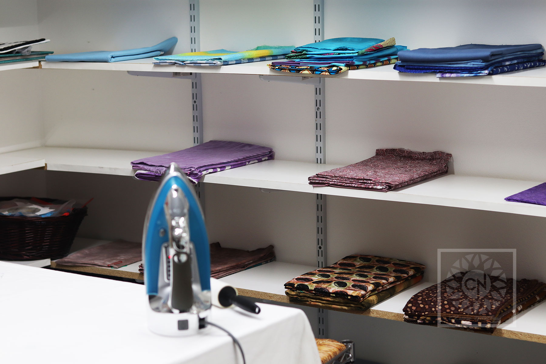 Organize your creative space and learn to fold your fabrics easily