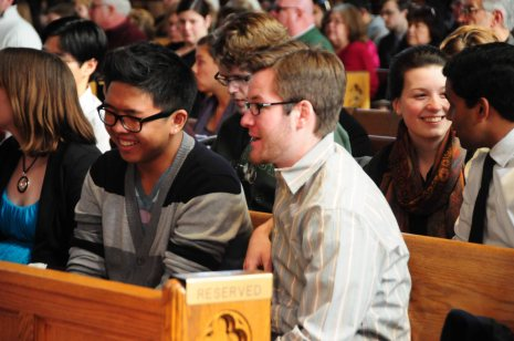 Wei Lin, 18, sits with his godfather Scott Boyle, 22, before the Holy Thursday Mass. Lin will be baptized in two days at the Easter Vigil with the other Rite of Christian Initiation for Adults (RCIA) candidates.