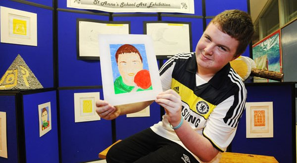 Ciaran Fawl from Newmarket displays his self-portrait during the launch of the St Anne's School Art and Craft Exhibition at Corrovorrin in Ennis. Photograph by Declan Monaghan