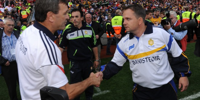 Clare manager David Fitzgerald meets with Cork manager Jimmy Barry Murphy following the All-Ireland senior hurling final at Croke Park. Photograph by John Kelly.