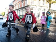 Senior Infants Seán Corry and John O'Connell make their way through the streets of Ennis during the annual Ennis National School Hallowe'en Hobble