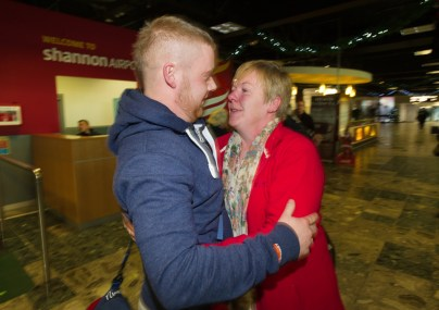 Liam Reale of Doon is greeted by his mother Pauline on his arrival home for Christmas at Shannon airport. Photograph by John Kelly.