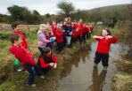 Ruth Costello, in water, with her Ballyvaughan NS senior classroom friends working on their BT Young Scientist project which involves measuring water samples in the Burren to test them for calcite. Photograph by John Kelly.