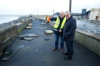 County manager Tom Coughlan and local business man Odran O Looney view the storm damage at Lahinch promenade. Photograph by John Kelly.