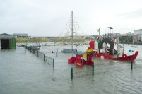 Storm damage and flooding in the playground at Lahinch promenade. Photograph by John Kelly.