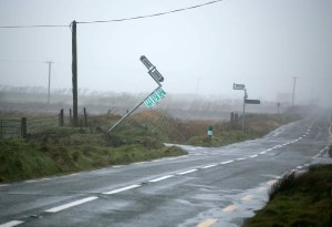 A signpost yields to the wind in West Clare. Photograph by Arthur Ellis