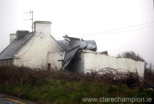 The roof from a shed begins to lift at a house near Doonbeg on Wednesday. Photograph by Arthur Ellis.