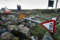 Rubble just off the main road in Kilbaha village where the road is covered by rocks, undermined in places and cut off following the latest high seas and gales at Kilbaha. Photograph by John Kelly.