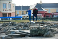 Walkers view of the destruction caused following the latest high seas and gales near the band stand in Kilkee. Photograph by John Kelly.