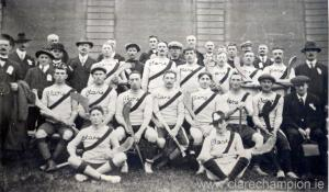 Players only, from left:  Extreme back row wearing dark jerseys are John Rodgers; Patrick McDermott and Patrick Moloney.  Standing l/r:  Tom McGrath; John Fox; Rob Doherty; Michael Flanagan; Jim Clancy; Joe Power.  Seated:  Jim Guerin; Patrick 'Fowler' McInerney; Willie 'Dodger' Considine; Amby Power; Martin Moloney; Ned Grace; John Shalloo.  Front seated:  Brendan Considine; James 'Sham' Spellissy.  Also in the photograph are Dr. T.P. Fitzgerald (team doctor); James O'Regan (chairman of Clare County Council); Jim O'Hehir (team trainer) and Stephen Clune (chairman of the Clare County Board).