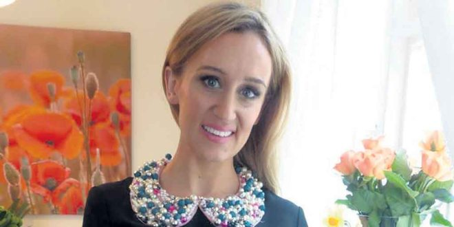 Marissa Carter, founder of Cocoa Brown, wearing one of Bríd's beaded collars.
