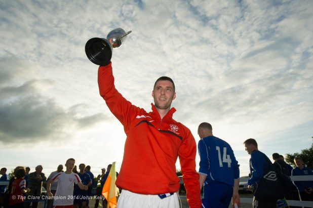 Newmarket Celtic A captain Michael Crosby lifts the silverware following the win over Ennis Town A in the Clare Cup final at the County Grounds. Photograph by John Kelly.
