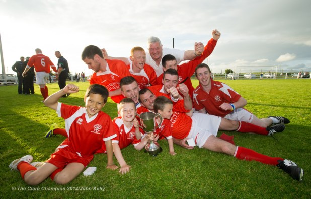 Members of the  victorious Newmarket Celtic A team and their supporters celebrate following the win over Ennis Town A in the Clare Cup final at the County Grounds. Photograph by John Kelly.