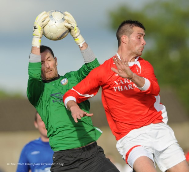 Stephan Loftus of Ennis Town A in action against Steven Kelly of Newmarket Celtic A during the Clare Cup final at the County Grounds. Photograph by John Kelly.