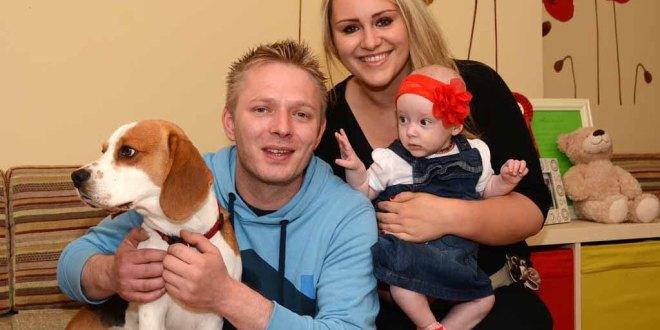 Daniel Drzewiecki and Julija Kolpakova at home with their baby daughter, Laura Olivia, and dog, Charlie.