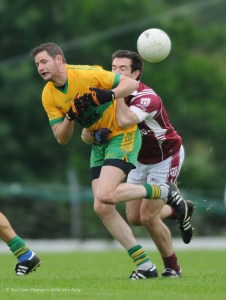 Damian Clohessy of O Curry's in action against Christy O Brien of Doora Barefield during their game in Kilmihil. Photograph by John Kelly.