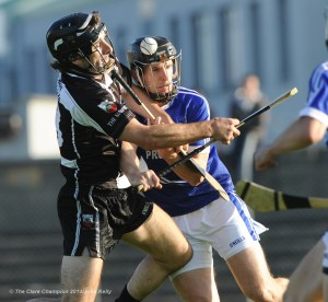 Eric Flynn of Clarecastle in action against Micheal Hawes of Cratloe during their semi-final at Cusack Park. Photograph by John Kelly.